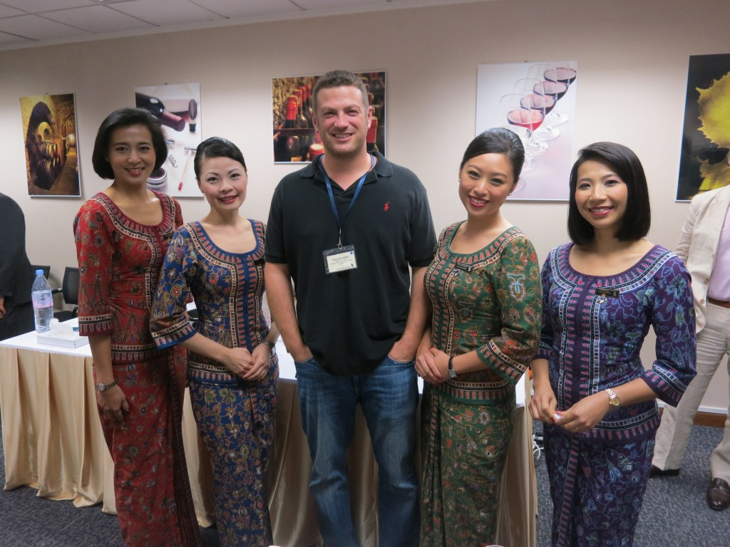 Lee Abbamonte with some Singapore Airlines cabin crew at an airline sponsored event in Singapore