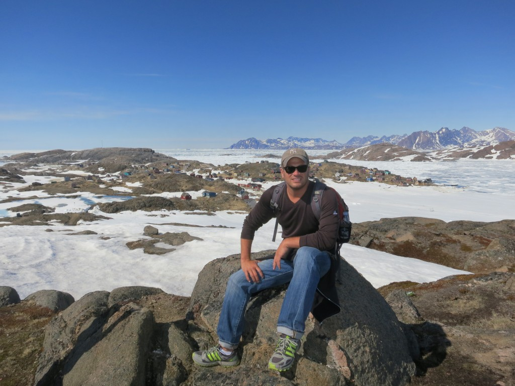 Atop a small village in Western Greenland