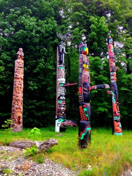 walking the seawall in stanley park, vancouver, british columbia, totem polls