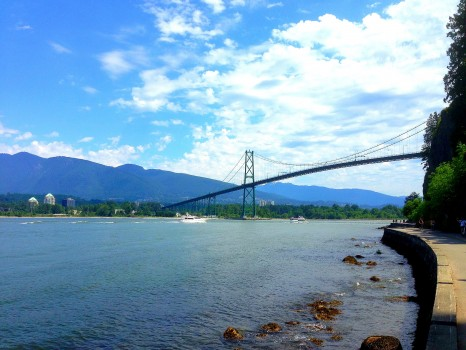 walking the seawall in stanley park, vancouver, british columbia, Lions Gate Bridge