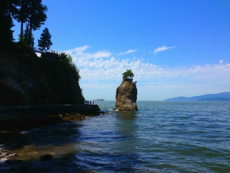 walking the seawall in stanley park, vancouver, british columbia, siwash rock