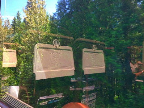 reflections in the windows of goldleaf class, Rocky Mountaineer, train, Canada, Vancouver, Jasper, British Columbia, Alberta