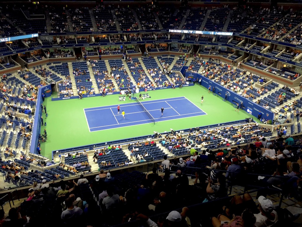 Exhibition doubles match after Federer won, with John McEnroe