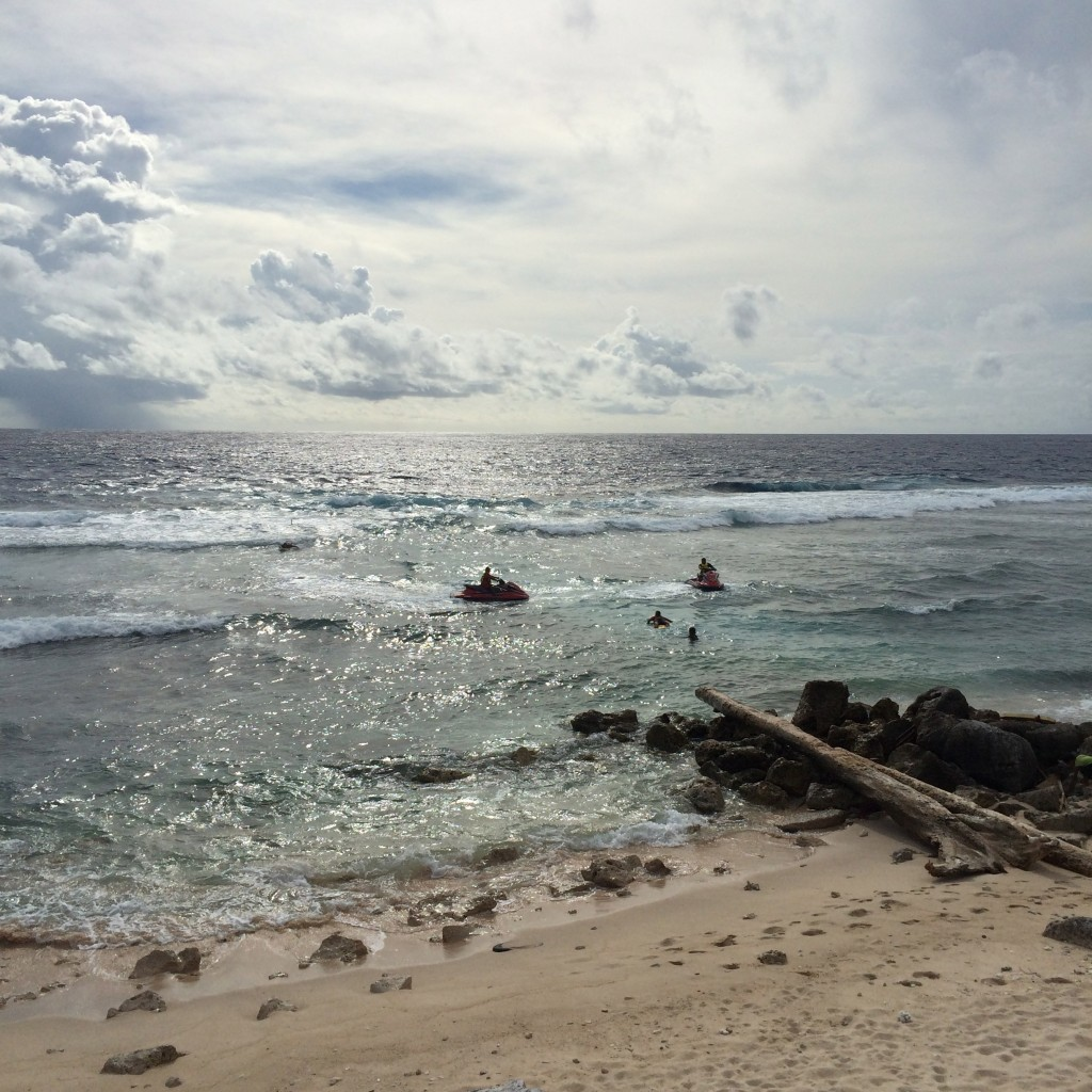 Nauru, locals swimming, jet skiing