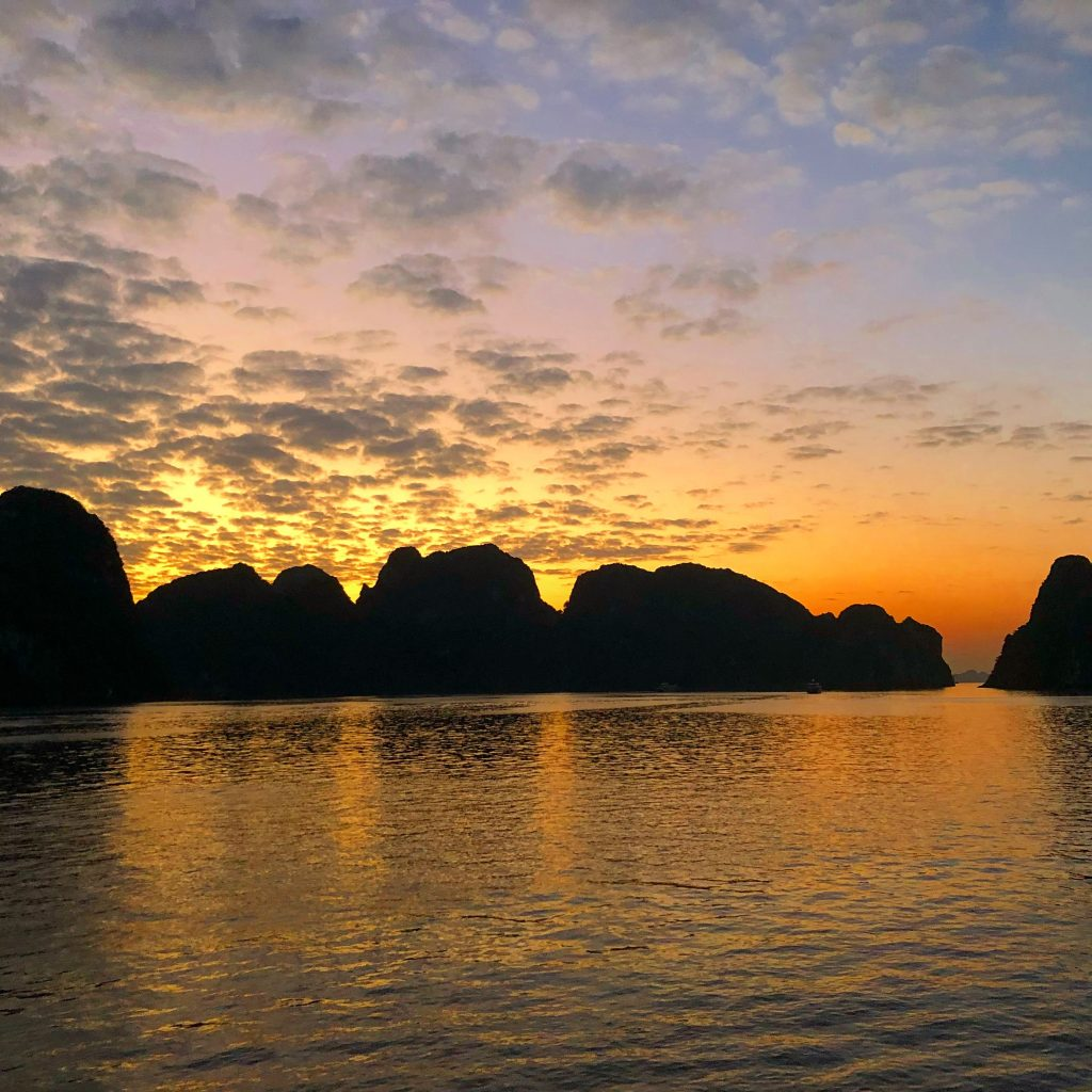 Sunset in Ha Long Bay is a magical thing