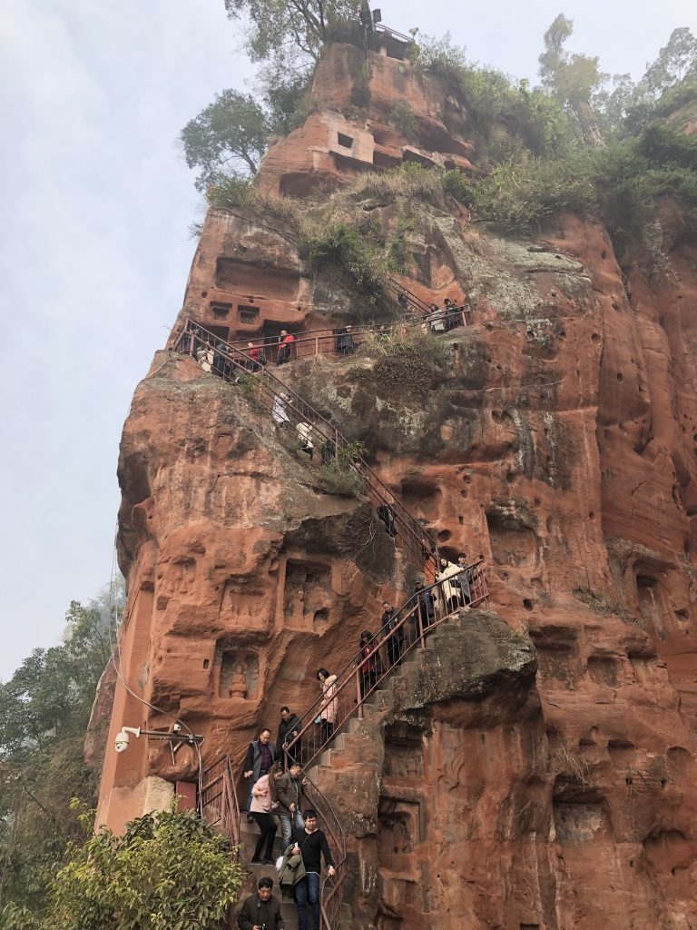 Climbing down 233 feet to the ground beneath Leshan Giant Buddha