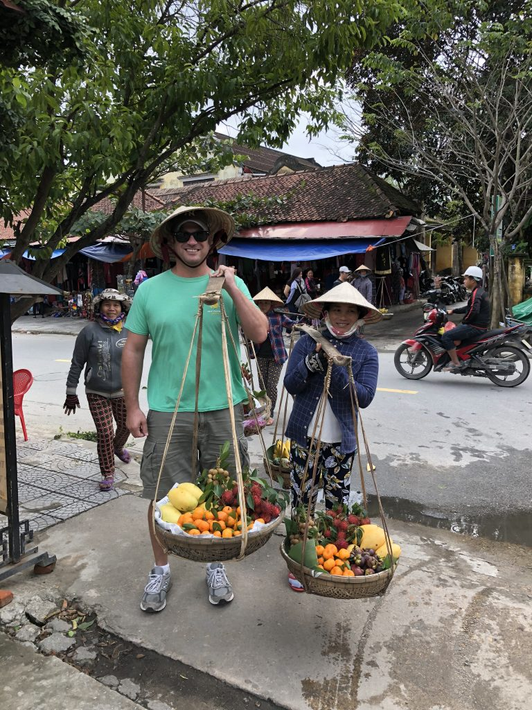 Trying my hand at selling fruit in Hoi An